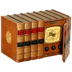 """Concealed broadcast radio by """"Emerson Radio & Phonograph Co., USA"""", 8 leather-bound volumes on """"History of Nations"""", 4 with hinged spines, assembled by """"Shryock Radio Company"""". 1939."""