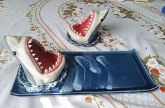 A shark sushi plate and shark soy sauce bowl that I will be mailing to a customer in Italy. #shark #sharkplate #sushi #soysauce #clay #ceramics #sculpture #sharkweek #etsy #shipping #italy #pottery #tableware