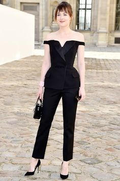 The Celebrity Style MVPs Of 2015 #refinery29  http://www.refinery29.com/2015/12/99498/best-celebrity-fashion-moments-2015#slide-26  The tuxedo finishes on this Dior pantsuit — like the satin-y sheen on the lapel, the fit at the waist, and the folded pockets — make this all-black set feel special. The Bardot neckline lends a ladylike sensibility. ...