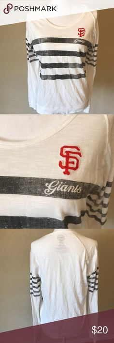 San Francisco Giants Long Sleeve Tee Soft and comfy San Francisco Giants shirts. I bought this when I was there last year to wear to a game, however I'm a St Louis girl so I haven't worn it since. Size Large but that is probably more of a juniors large. I am an 8-10 and it fit me and was just roomy enough. 100% Cotton. 47 Tops Tees - Long Sleeve