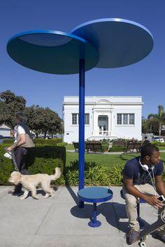 Redesigned bus shelters in Santa Monica comprising blue discs on stilts. Landscape Plane, Landscape And Urbanism, Landscape Elements, Urban Landscape, Urban Furniture, Street Furniture, Metal Furniture, Furniture Plans, Concrete Furniture
