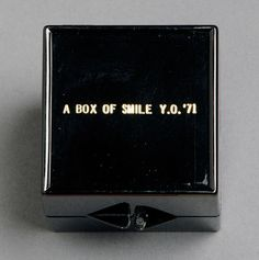 "Yoko Ono, A Box of Smile, ReFlux Edition, plastic box inscribed in gold: ""a box of smile y. Yoko Ono, Fluxus Art, John Cage, Bicycle Playing Cards, Box Art, Art Boxes, Art Object, Mail Art, Conceptual Art"