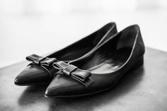 Pointed black flats with bow.