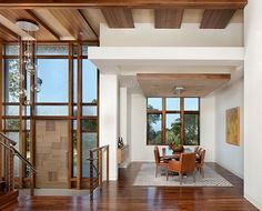 Cool door and interesting ceiling treatment.