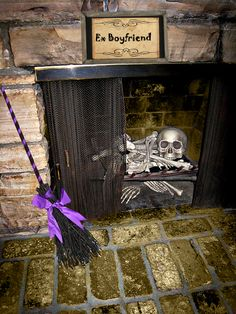A bag of bones, a broomstick and a sign and you have the BEST Halloween fireplace decor evah!  Halloween Fashionista Fabulous Witches Theme Party & Decorating Ideas