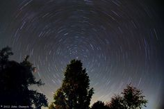Star trails, Warrenton, VA, USA. (Credit: John Chumack) Polaris, is the stationary point over a Sequoia tree. This is a 30-minute exposure. Longer exposures give more dramatic effects. more dramatic the effect!""