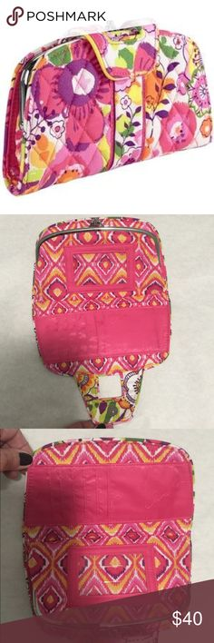 Vera Bradley Clementine Kiss n Snap Wallet NWOT Vera Bradley Clementine Kiss n Snap Wallet is NWOT. This spectacular retired floral print includes the colors pink, orange, lime green and purple. The interior features a bright pink embossed lining with multiple card slots, two center compartments and double clasps. Silver tone hardware. This pretty wallet holds a lot! A great way to keep all your receipts organized until you file or toss them. Perfect condition. Never used. Last photo is…