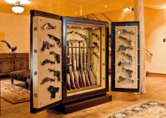 Customized gun safe the true man cave.  This is appropriate gun storage for a real man to keep his guns from the wrong hands!!!  ALL GUN OWNERS NEED ONE!!!