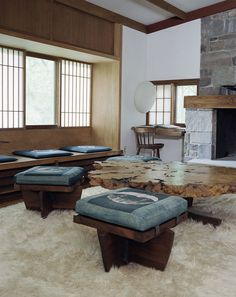 GEORGE NAKASHIMA, A view from Nakashima's New Hope Studio Reception House featuring Greenrock ottomans and a Buckeye burl coffee table. / Dwell