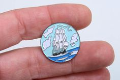 This is a round enamel lapel pin of a sailing boat in the sea with clouds in the sky The pin it's soft enamel on a golden metal tone base Vintage pins are hard to find, don't miss it Buy 4 lapel pins and pay only 3 This is an offer for the lapel pins section and consists in buying 4 pins and pay 3 and only one shipping cost How it works? -You can tell me the pins you want, and I make an ad for you with the new prize -You buy 4 pins and I refund you one pin and the over shipping cost…