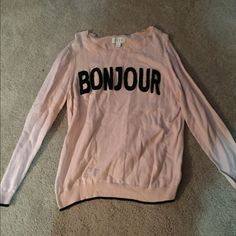 Bonjour top Leaning toward this being a light sweatshirt. Very cute! Tops Sweatshirts & Hoodies