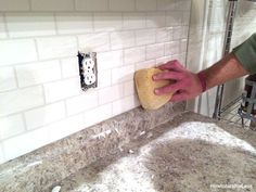 DIY: How to Install, Grout and Caulk a Subway Tile Backsplash - this is an awesome post that has so many useful tips. The cost of this project was less than $250 and it completely transformed the room - via How to Nest for Less