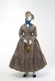 This maternity dress has been made with slits at the side, forming a drop apron at the front to allow for an expanding waistline. The front-opening bodice is unusual for this period, and allows ease of movement for nursing. This dress features a cross-over, front-opening bodice, which was unusual for this period. However this high-waisted style would have been most comfortable for maternity wear, allowing ease of movement for nursing.