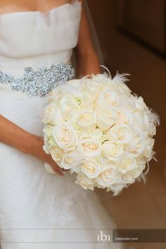 Gorgeous bouquet of roses and hydrangea with a touch of feathers