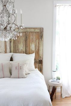 Love the rustic look of the headboard. (chandelier - not for me)