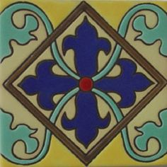 """Gothic relief tiles are highly decorative. They are manufactured by Rustica House in Mexico and often used for kitchen backsplash and stair risers. Relief Tile """"Navy Blue Cross Flordelisada"""" by Rustica House. #myRustica"""