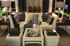 eclectic living room with a light couch and punchy accessories