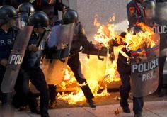 Eduardo Verdugo/AP A police officer is engulfed in flames after being hit by a Molotov cocktail thrown by protesters marking the anniversary of the Tlatelolco massacre in Mexico City, Wednesday Oct. 2, 2013. Mexico commemorated the 45th anniversary of the massacre of students holding an anti-government protest ten days before the 1968 Summer Olympics celebrations in Mexico City. (Eduardo Verdugo/AP)