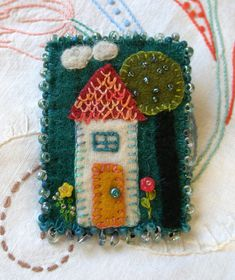 Home Sweet Home is where we dream, are nurtured and are loved. Its the perfect subject for a little wool brooch. The deep colors bring warmth and