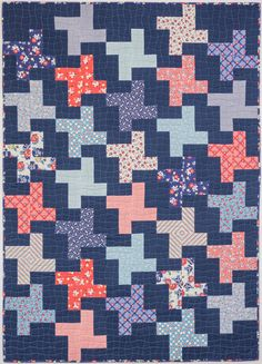 Pinwheels quilt, machine quiltied with a wavy grid design using a walking foot/dual feed