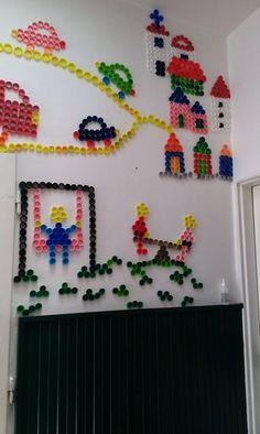 The wall full of plastic bottle caps