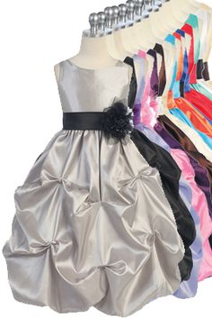 This is the perfect dress for a wedding, pageant, flower girl, formal dance, party or other special occasion!  Taffeta sleeveless dress  Gathered skirt Removable sash at the