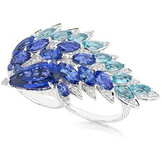 Stephen Webster Tanzanite Magnipheasant Plumage Double Finger Ring ($35,000) ❤ liked on Polyvore featuring jewelry, rings, anillos, blue, stephen webster jewelry, stephen webster rings, blue ring, blue band ring and band jewelry