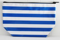 "CS-Stripe Royal.   Our ""Original"" Cosmetic Bags! Long before the Ellie Cosmetic Bags, these were our very first cosmetic bags. Available in 3 sizes and all feature a zipper and lined with a coordinating Oilcloth pattern of our choice. Never Stains, just wipe clean when your makeup spills or the chocolate bar melts!  Monogramming available.   #sarahjanesoilcloth #love #madeintheusa www.simplysjo.com"