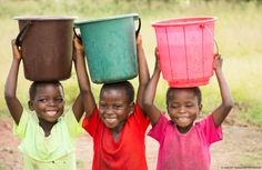 """Sheleshita, Maureen and Sikola, all 7 years old, met at the new UNICEF-supported water point in their village in Malawi. The young girls no longer have to walk 5km each day to fetch water, leaving more time for study and play. When asked what water means to them, they simply smile. """"Water is happiness"""", Sikola says. © UNICEF Malawi/2015/Chikondi"""