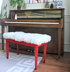 Another shot of the remodeled Sheepskin piano bench. This is an easy project to conquer for beginner upholsterers because the thick sheepskin is very forgiving with corners, and even mistakes | #music #room #DIY #decor #project