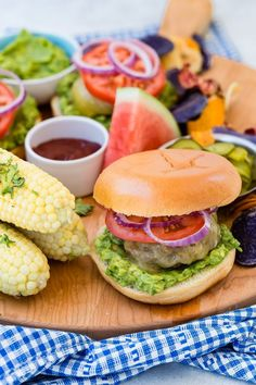 As I was starting to plan our Memorial Day menu and going through a few favorite recipes Chloe asked me if I would make hamburgers. How, after almost 10 years since Weelicious started has there been no beef burger recipe on the site?! That is all about to change. This Guacamole Cheddar Burger will make all of your long weekend wishes come true and more!