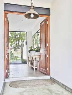 House in a valley is situated in Waterfall Estate, securely enveloped within its context. This home pays homage to environmentally sound principles. Entrance, Entrance Design, Framed Bathroom Mirror, Living Area, House, Modern, Home Decor, Modern Industrial, Modern Entrance