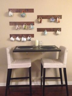 DIY mug hangers, stained precut wood with some hooks  I collect mugs and I wanted an easy way to show them off.
