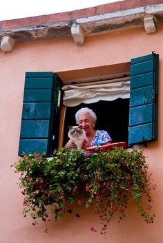 Venetian Nonna showing off her beautiful cat. Wow, I didn't know that my cat was Italian!