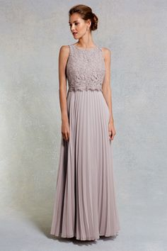 This modern style is a charming choice for your next event. The Delia Maxi Dress is a contemporary piece with its clean cut and beautiful cropped lace overlay. Featuring a cropped bodice and pleated skirt, this stunning style is closed with a concealed back zip. From neck to hem dress length is 132cm/52 inches. Height of model shown: 5ft 9inches/175cm. Model wears: UK size 10.