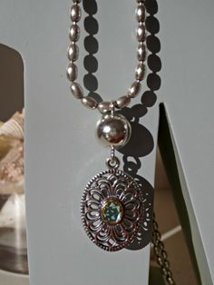 Pandora Australia vintage collection earring pendant attached to a chain with a necklace S-lock and clip.  Another way to use your Pandora compose earrings