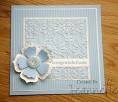 handmade card ... baby blues ... embossing folder texture ... layered flower  ... lots of layers in square format ... great card! ... Stampin' Up!