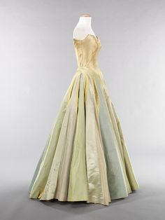"""Ribbon"" ball gown, 1947 Charles James (American, born Great Britain, 1906–1978) Silk: cream, yellow, and gray satin; blue faille; gray and pale green taffeta Brooklyn Museum Costume Collection at The Metropolitan Museum of Art, Gift of the Brooklyn Museum, 2009; Gift of Arturo and Paul Peralta-Ramos, 1954 (2009.300.1187)"