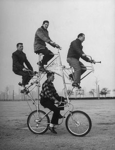 """""""Four-man bicycle is powered by five chains and has brakes on both its wheels. The bike was built by Art Rothschild (top position) who broke three ribs while learning how to ride it."""""""