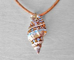 Painted Shell Necklace - Hand Painted Sea Shell Pendant on Leather Cord. $35.00, via Etsy.