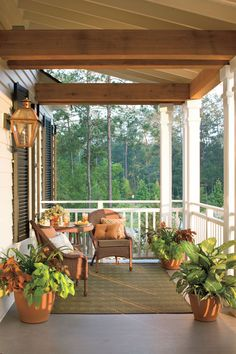 This second-story porch is an extension of the master suite and offers a great view of the sunrise. A copper light fixture complements the warm wood accents.    Tour the Bayou Bend Idea House