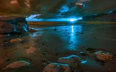 sunset beach stones scenic blue light