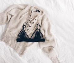 Black lace bra + an Isabel Marant lace-up sweater.