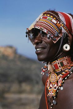 Africa | Elaborate headdress and body adornments worn by Samburu moran (warrior) | © John Warburton-Lee