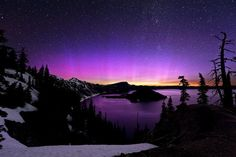 Photographer Brad Goldpaint captured this view of the northern lights over Crater Lake, Ore.