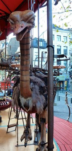 A mean-looking ostrich on a Brussels, Belgium, steampunk-ish merry-go-round