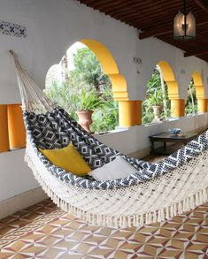 Having a great hammock or a swing in your backyard is cool, but putting one up inside your home? Now that's a refreshing way to give a new meaning to hanging out. There's something extra cozy (not to mention totally chic) about indoor hammocks and hanging chairs—it's like you can just curl up and float on cloud nine right there in your living room. No matter what your style is, from rainbows to macramé, there's a hanging retreat for everyone on this list. Indoor Hammock Bed, Hammock In Bedroom, Backyard Hammock, Large Backyard, Camping Hammock, Hammock Beach, Eno Hammock, Portable Hammock, Hammocks