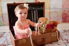 We all have a suitcase at home!  Fill it with fun things.  Create your theme. baby prop ideal