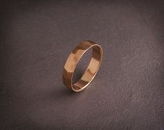 ✿ DESCRIPTION  A handmade solid 14k rose gold band.  Mens wedding band, in most cases, is the only piece of jewelry you wear. As such, the design needs to be clean and simple indicating your status but integrates into your outfit smoothly.  This wedding band design has a clean faceted texture with matte finish. Adding a little edge to the clean design.   THE BAND  Made from solid 14k gold, 1mm thick, flat sheet. The ring in the photos is 4mm wide, other band width can be selected from the…