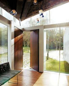 Modern Angular Rural Family Home in Canada - Photo 5 of 13 - Walnut doors come together to form a corner in the entry foyer. Modern Foyer, Modern Front Door, Entry Foyer, Entry Doors, Front Doors, Exterior Doors, Design Entrée, Design Ideas, Modern Design